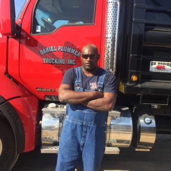 Man standing in front of semi-truck