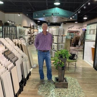 Man standing in tile showroom