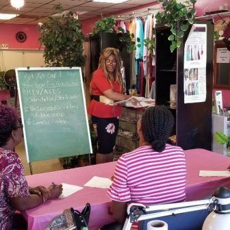 Salon owner teaching educational workshop to students